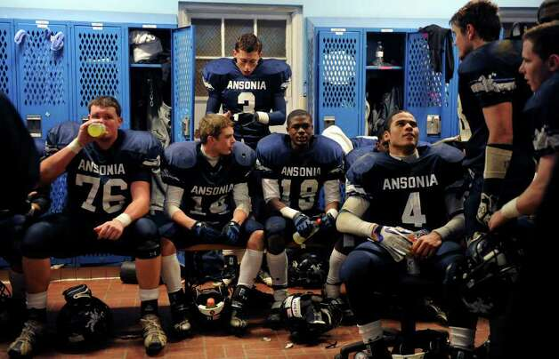 The Ansonia team sits in the locker room at halftime of its 51-22 victory over Wilby High School on November 11th, 2011. The team went on to finish the season 14-0, and won the state championship. Photo: Christian Abraham / Connecticut Post