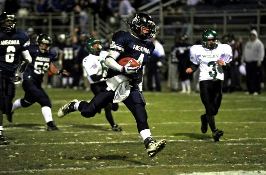 A look at the Ansonia football program and the multi-generational reach it has, during a recent game against Wilby in Ansonia, Conn. on Friday November 11, 2011. Ansonia's #4 Andrew Matos enters the endzone for a touchdown. Photo: Christian Abraham / Connecticut Post
