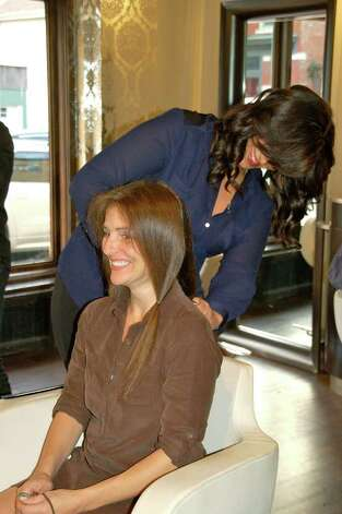 NSS teacher Vikki Cappiali donates her hair with help from Salon O stylist, Frankie. Photo: Contributed Photo