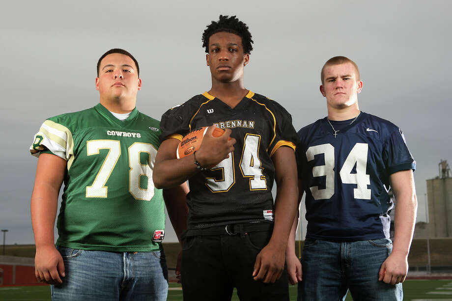 The Class Sub-5A All-Area defensive linemen at Heroes Stadium. Sunday, Dec. 11, 2011. From left, Roland Gonzalez (McCollum), Derick Roberson (Brennan) and George Schwanenberg (Smithson Valley). Not pictured Javonte Magee (Sam Houston). JERRY LARA/glara@express-news.net Photo: JERRY LARA, San Antonio Express-News / SAN ANTONIO EXPRESS-NEWS