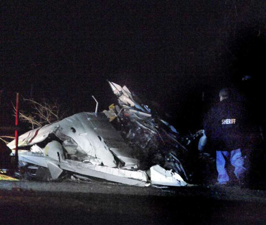 The crash site of a single-engine airplane is seen Monday night, Dec. 19, 2011 in northeastern Brazos County, Texas. The crash killed five people, including two children. The flight originated in Atlanta, stopped in Jackson, Miss., and was headed for Waco, Texas, when it crashed in a field north of Bryan and College Station. The victims may have been related, a state official said Tuesday. Photo: AP