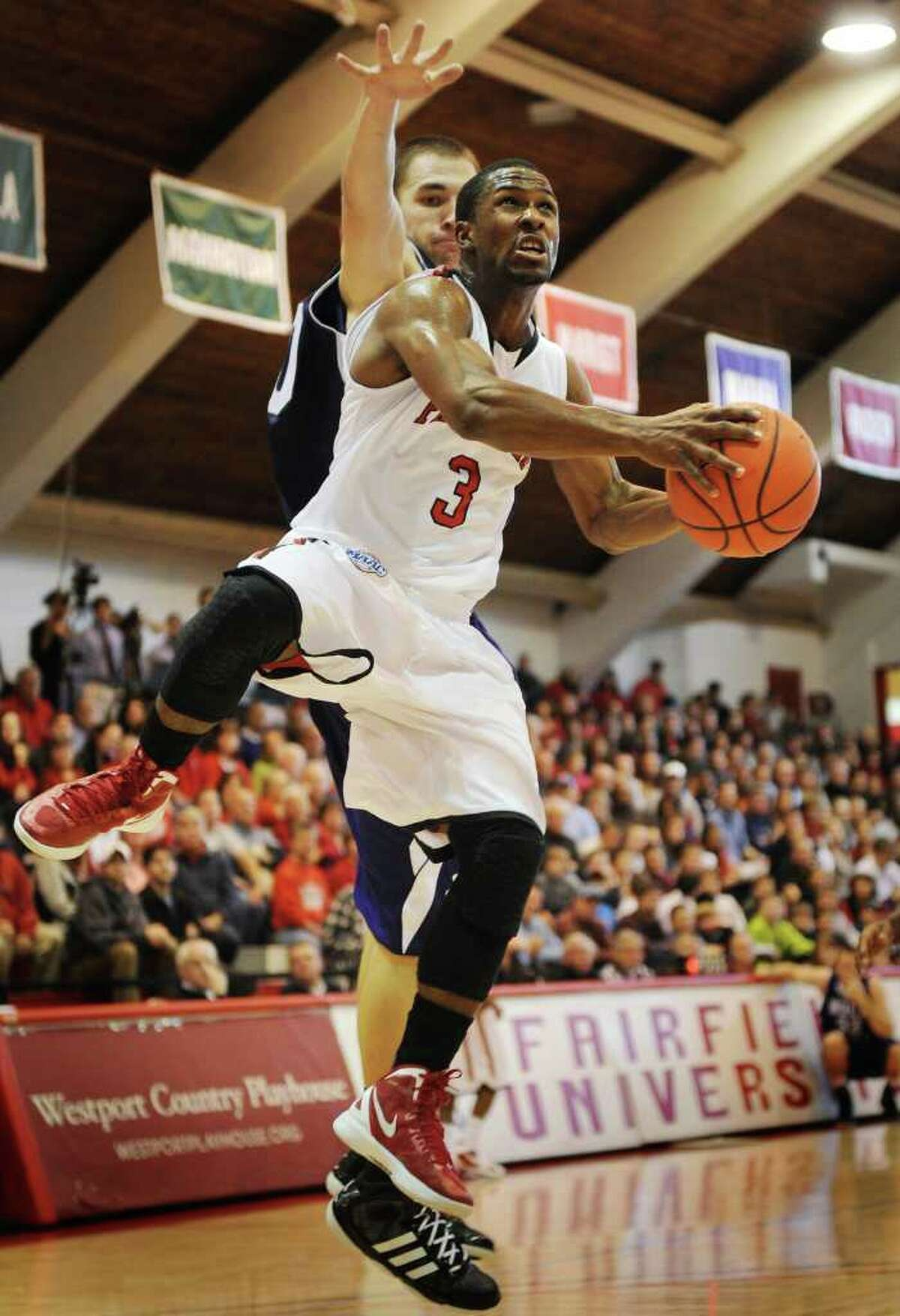 Fairfield's Derek Needham drives to the basket during the Stags' victory over Holy Cross at Alumni Hall in Fairfield on Sunday, November 20, 2011.