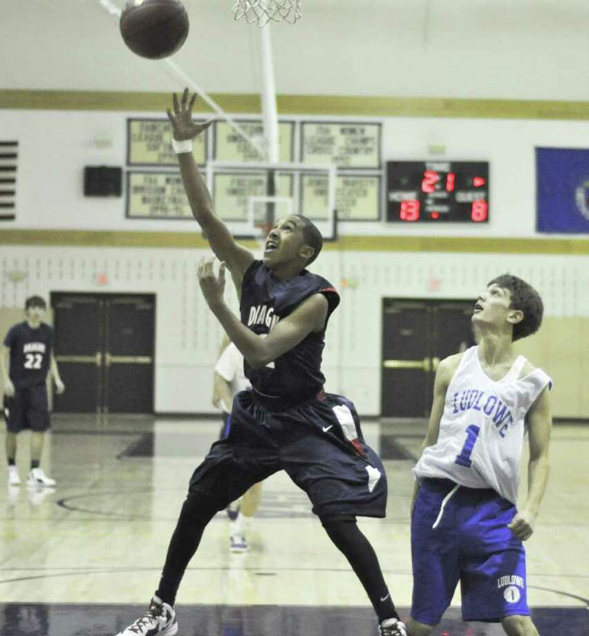 Greens Farms Academy seventh grader Tremont Waters attempts a layup last week. Waters continued to be an offensive threat for the Dragons, averaging 10 points a game against Harvey and Hamden Hall last week. Photo: Contributed Photo