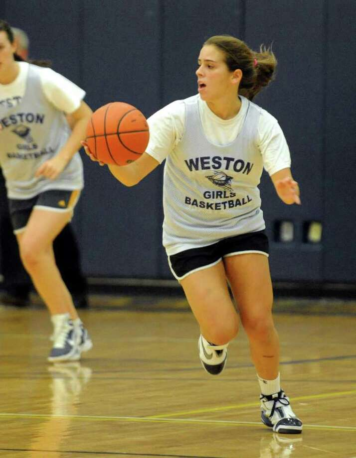 Weston's Morgan Moubayed dribbles in a preseason scrimmage. Moubayed had six points and three steals Saturday in a 69-38 loss at Bacon Academy. Photo: Christian Abraham/Staff Photographer / Connecticut Post
