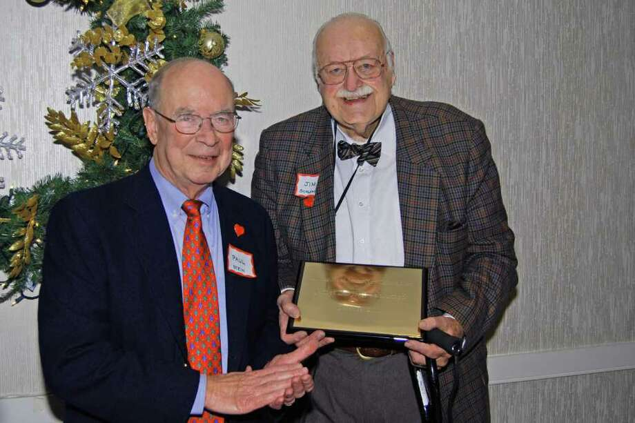 New Canaan Senior Men's Club President Paul Stein presents James D. Schlumpf with the Distinguished New Canaan Senior Man Award. Photo: Paresh Jha