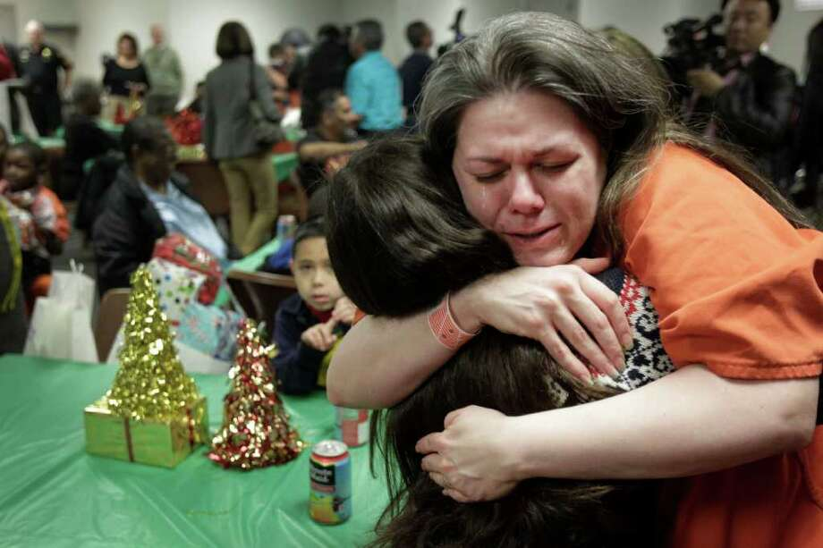 Harris County inmate Brandi Vela cries as she hugs her daughter, Jazmine Vela, 10. A Christmas event for 15 female inmates in the Harris County Sheriff's Office Reentry Services Program allowed them to spend time with their children on Tuesday. The inmates had presents donated by Navidad en el Barrio to give their children.  The women are minimum risk inmates who have had good relationships with their children.  Photo: Melissa Phillip, Houston Chronicle / © 2011 Houston Chronicle