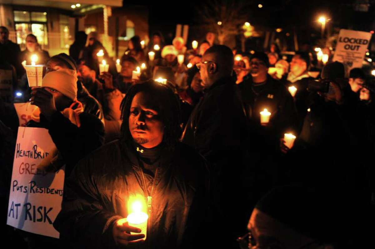 Locked-out employees of West River Health Care Center and members of the New England Health Care Employees Union from other parts of the state and members of the community come together Tuesday, Dec. 20, 2011 outside the health care center in Milford, Conn. for a Quality Care Candlelight Vigil calling for parent company, HealthBridge, to