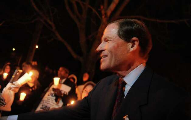Sen. Richard Blumenthal shows his support for locked-out employees of West River Health Care Center Tuesday, Dec. 20, 2011 during a candlight vigil outside the health care center in Milford, Conn. Photo: Autumn Driscoll / Connecticut Post