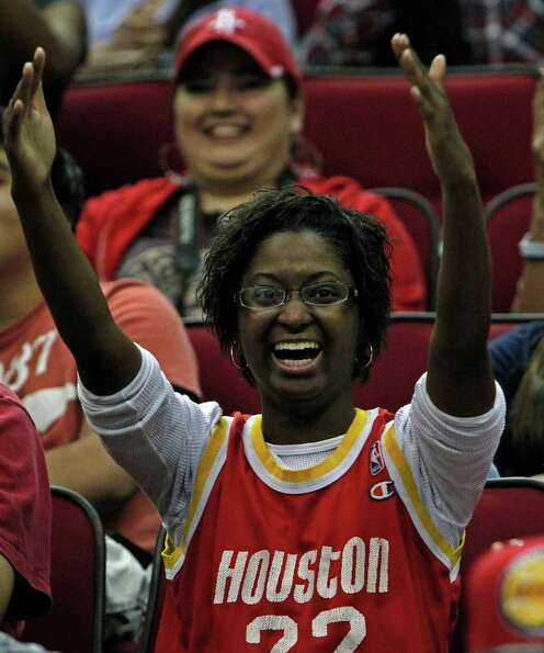 Chanel Lewis cheers during the Houston Rockets open practice at the Toyota Center Tuesday, Dec. 20,