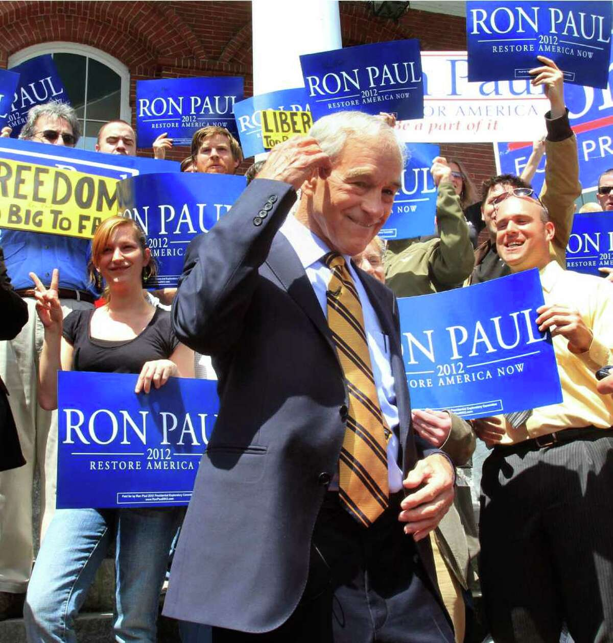 Rep. Ron Paul, R-Texas, campaigns in New Hampshire in May. Since then, he's steadily built a strong base in Iowa. If he wins in Iowa, he, Iowans and the GOP will have a lot of explaining to do about the stances he's taken. And what he's written.