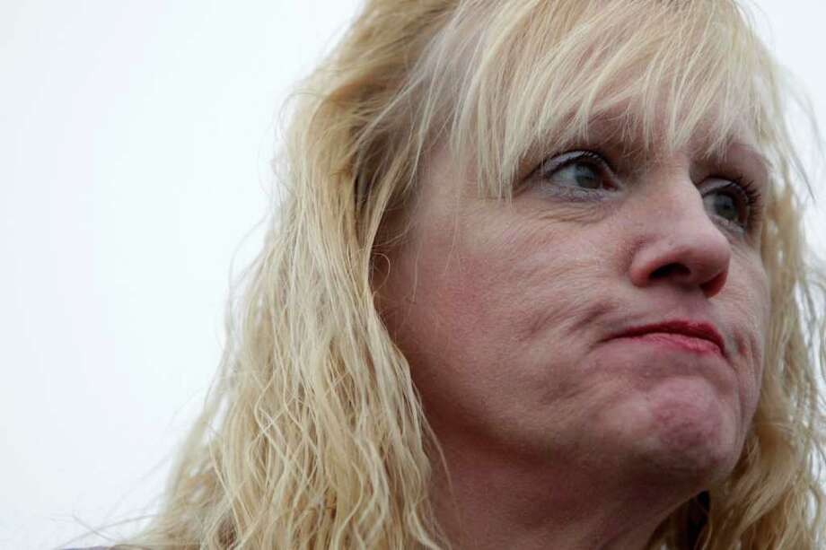 Mari Gilbert, mother of Shannan Gilbert, speaks at a news conference near the site where her daughter's remains were found in Babylon, N.Y., Tuesday, Dec. 20, 2011.  Gilbert, the mother of a prostitute whose remains were found in a Long Island marsh, says she believes her daughter was murdered by a serial killer, and wants federal authorities to take over the investigation. (AP Photo/Seth Wenig) Photo: Seth Wenig