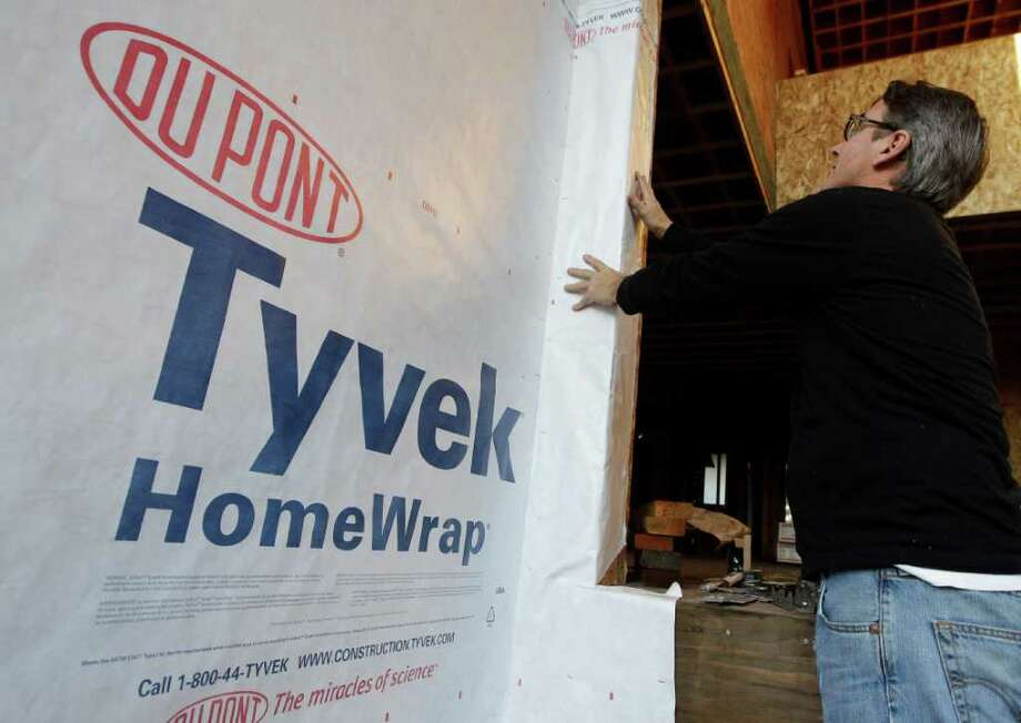 In this Nov. 22, 2011 photo, construction worker Will Capper works on a new house in Palo Alto, Calif. A surge in apartment construction gave builders more work in November. But 2011 is still shaping up to be one of the worst years in history for homebuilders. (AP Photo/Paul Sakuma) Photo: Paul Sakuma