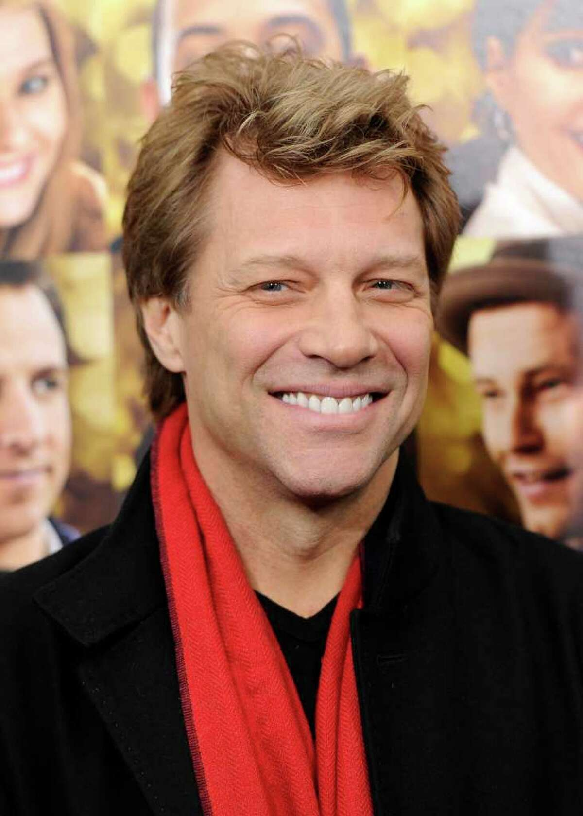 """FILE - In a Wednesday, Dec. 7, 2011 file photo, singer Jon Bon Jovi attends the premiere of """"New Year's Eve"""" at the Ziegfeld Theatre in New York. Bon Jovi wants fans to know he's not dead, and he has posted a photo proving it. False reports of the New Jersey-born musician's death spread online after a fake news release surfaced Monday, Dec. 19, 2011 on social media sites. (AP Photo/Evan Agostini, File)"""
