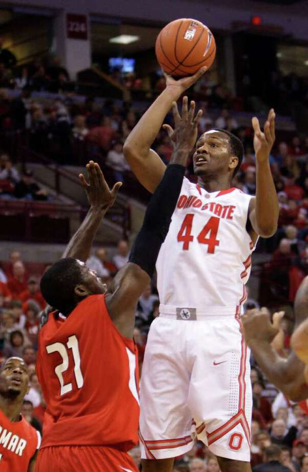 Ohio State's William Buford, right, shoots over Lamar's Charlie Harper during the first half of an NCAA college basketball game Tuesday, Dec. 20, 2011, in Columbus, Ohio. (AP Photo/Jay LaPrete) Photo: Jay LaPrete, FRE / FR52593 AP