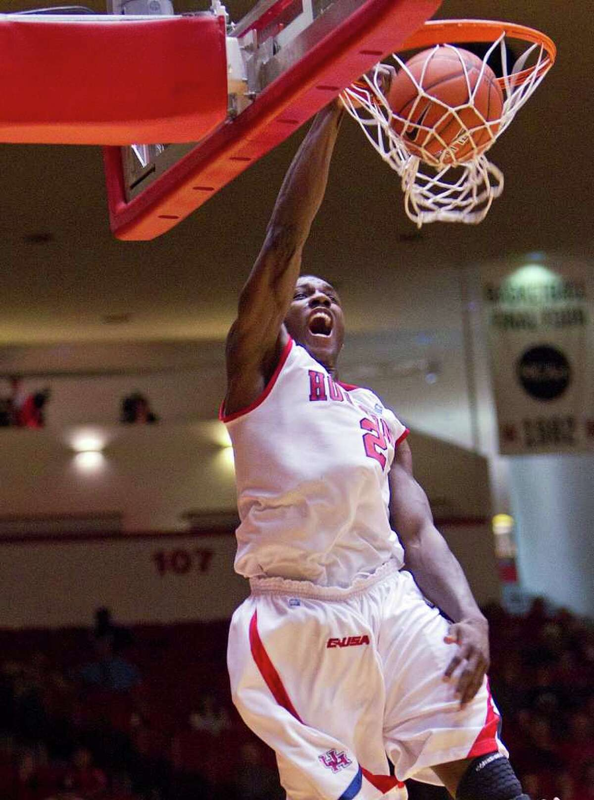 Houston's Alandise Harris (2) slams one home during the first half of an NCAA basketball game between Houston and USTA Tuesday, December 20, 2011 in Houston.