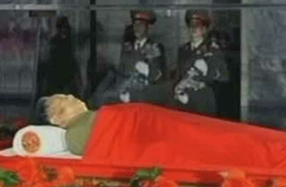 In this image made from KRT television, the body of North Korean leader Kim Jong Il is laid in a memorial palace in Pyongyang, North Korea, Tuesday, Dec. 20, 2011. (AP Photo/KRT) TV OUT NORTH KOREA OUT