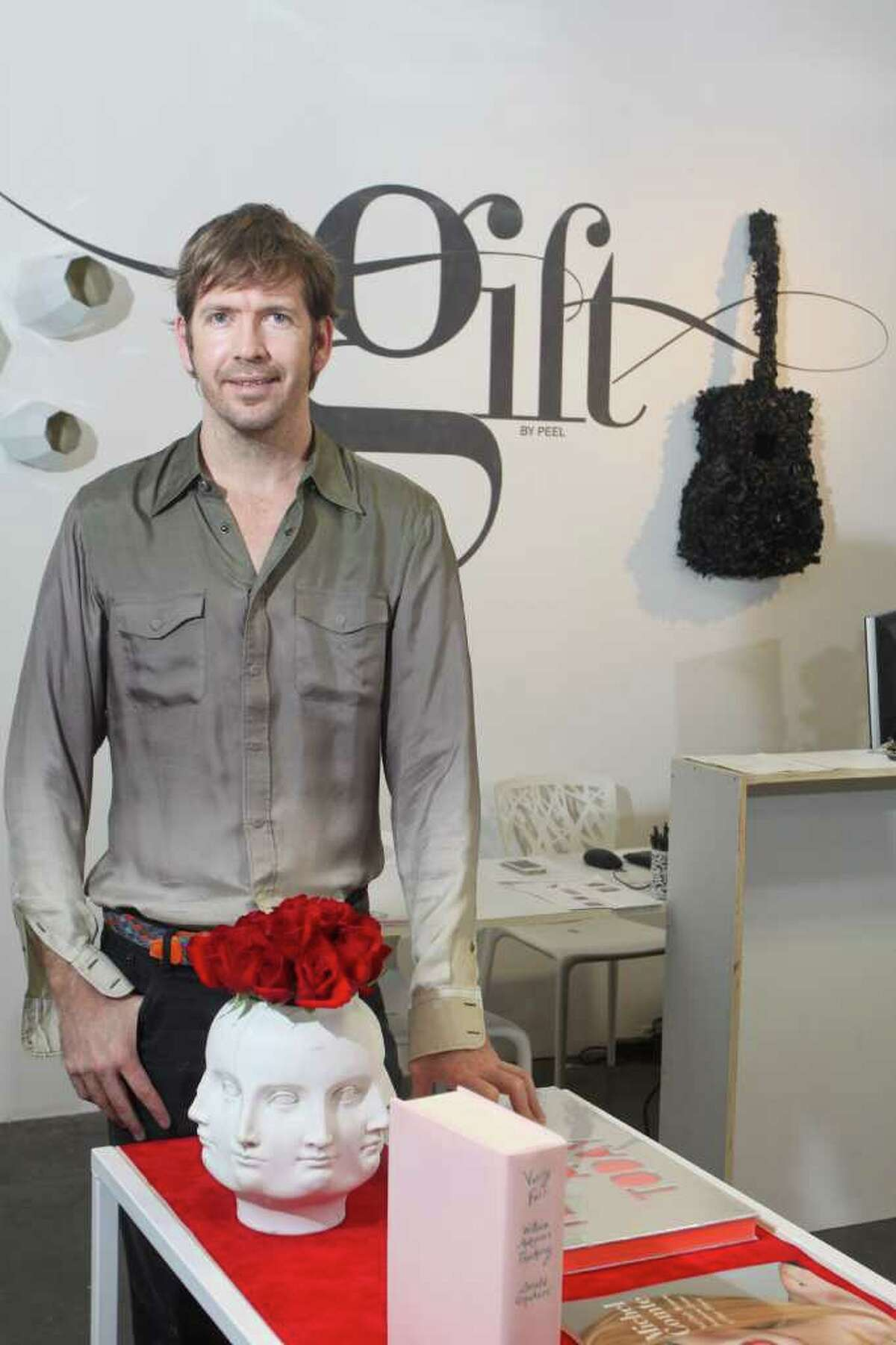 Gary Fountain : For the Chronicle ALTERNATIVE: Steve Hempel, owner of Peel Gallery on Montrose, sells traditional gift items at his pop-up store called Gift in West Ave Shopping Center.