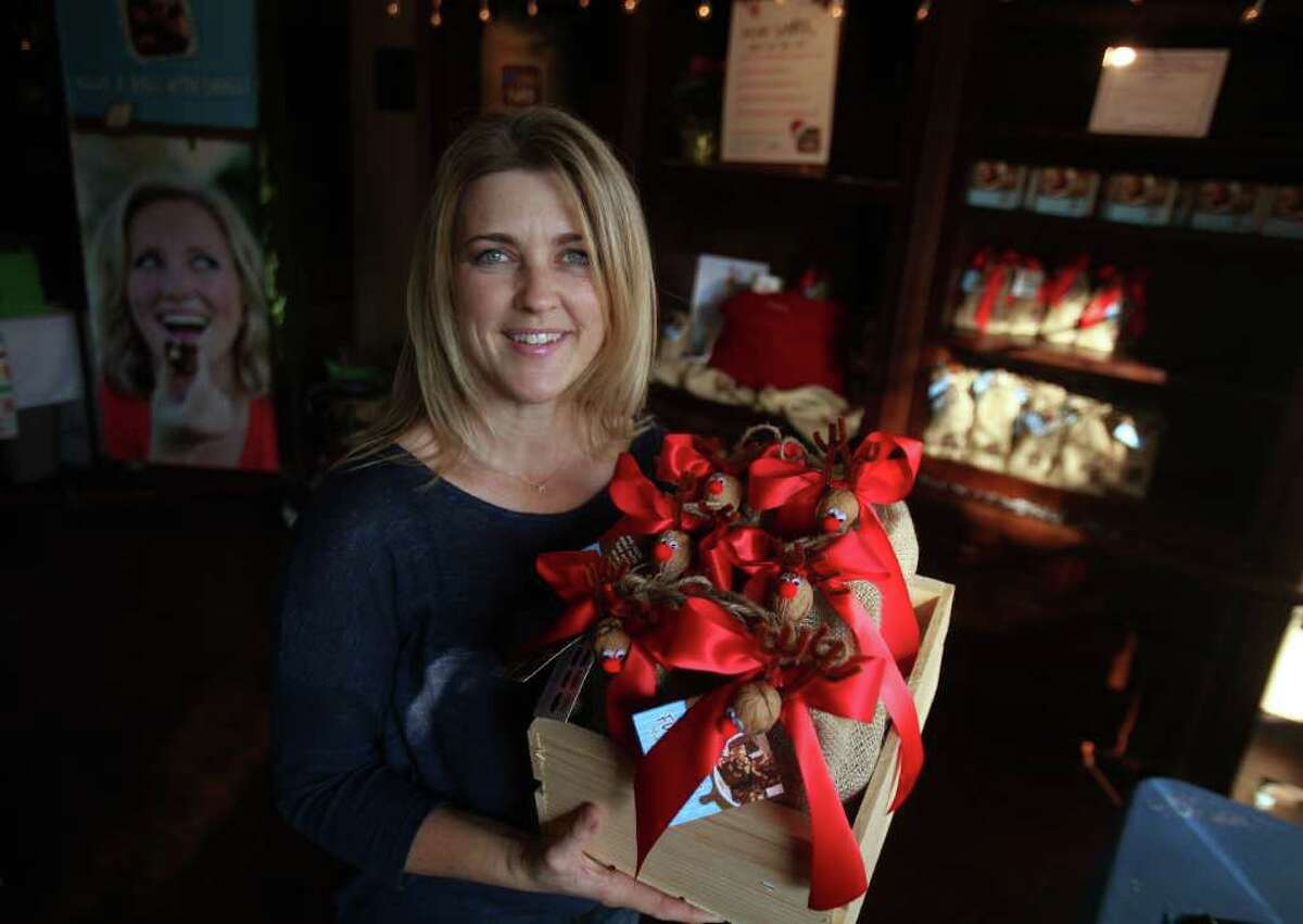 Mayra Beltran : Chronicle SWEET TIME OF THE YEAR: Robin Strickland, owner of Big Little Fudge, sells 13 varieties of fudge at her temporary, 200-square-foot store at Market Square in The Woodlands. Strickland has a permanent store in Montgomery.