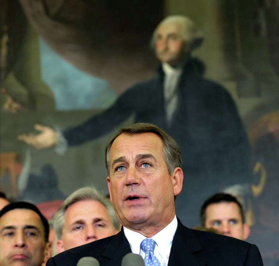 House Speaker John Boehner of Ohio, surrounded by his colleagues, speaks during a news conference on Capitol Hill in Washington, Tuesday, Dec. 20, 2011. The House Tuesday rejected a plan backed by President Barack Obama to extend a 2 percentage point payroll tax cut for two months to buy time for talks on a full-year renewal. Republicans controlling the chamber are instead demanding immediate talks with the Senate on a year-long plan.   (AP Photo/Susan Walsh) Photo: Susan Walsh