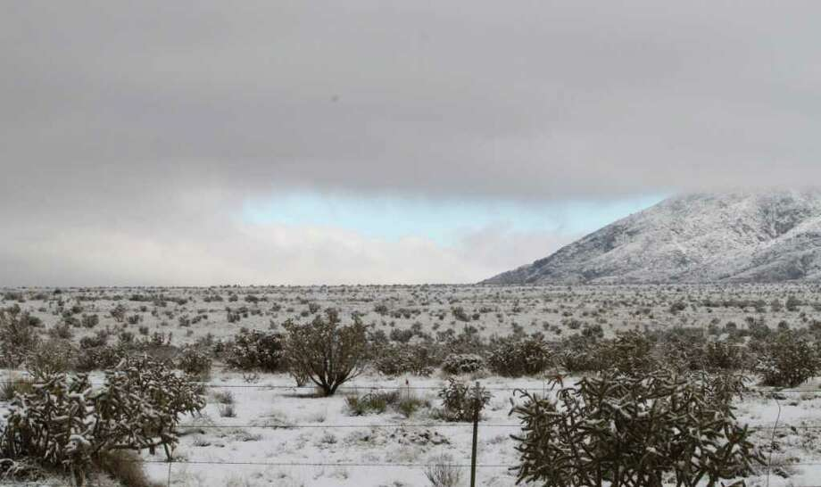 Fog begins to lift from the Sandia Mountains near Albuquerque, N.M., on Tuesday, Dec. 20, 2011, after a major winter storm moved through the state. New Mexico highway officials say they are mopping up and getting major thoroughfares reopened. (AP Photo/Susan Montoya Bryan) Photo: Susan Montoya Bryan