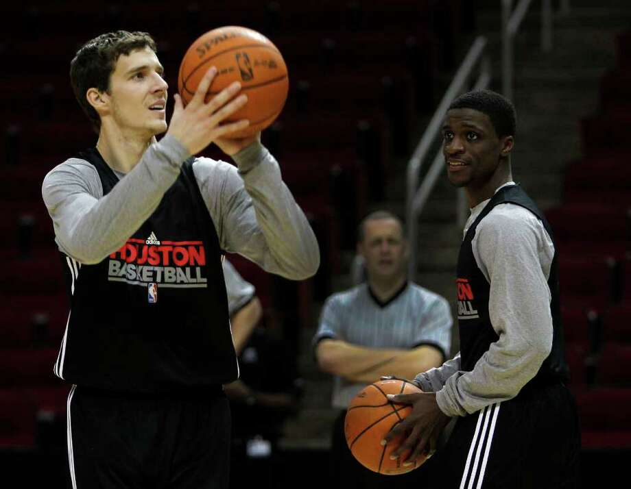 'WE JUST PLAY': Rockets backup point guards Goran Dragic, left, and Jonny Flynn are ready to step onto the court should their numbers be called. Photo: James Nielsen / © 2011 Houston Chronicle