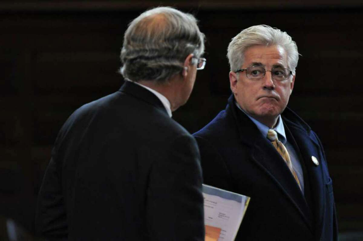 Clement Campana, President of the Troy City Council, right, is arraigned for his role in a ballot fraud case in Rensselaer County Court while sitting with his lawyer E. Stewart Jones, Jr., left, on Tuesday Dec. 20, 2011 in Troy, N.Y.. (Philip Kamrass / Times Union )