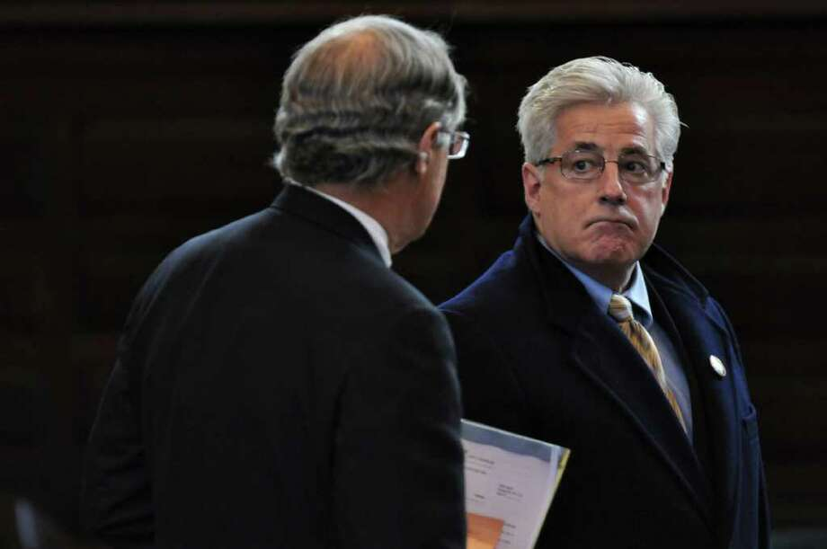Clement Campana, President of the Troy City Council, right, is arraigned for his role in a ballot fraud case in Rensselaer County Court while sitting with his lawyer E. Stewart Jones, Jr.,  left, on Tuesday Dec. 20, 2011 in Troy, N.Y.. (Philip Kamrass / Times Union ) Photo: Philip Kamrass / 00015833A
