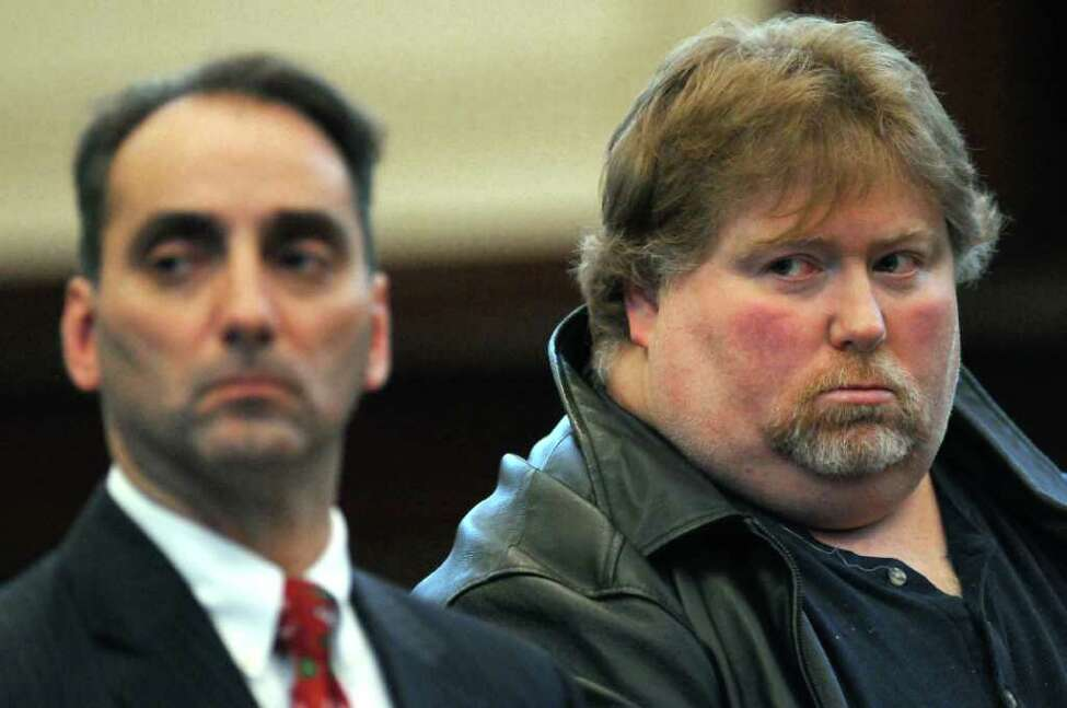 Anthony DeFiglio, right, is shown in Rensselaer County Court on Dec. 20, 2011, in Troy, N.Y. His lawyer John Turi is at left. (Philip Kamrass / Times Union archive )