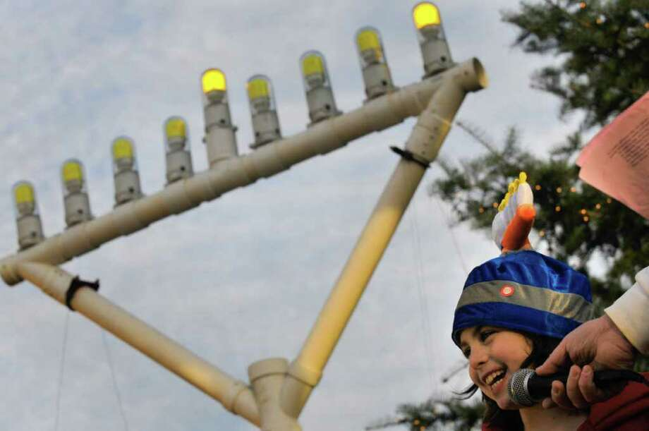 "Nine-year-old Ella Kasper of Delmar sings ""The Dreidel Song"" during a Menorah lighting ceremony in Delmar, NY Tuesday, Dec.20, 2011.( Michael P. Farrell/Times Union) Photo: Michael P. Farrell"