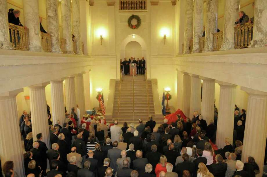 People gather in the rotunda during the swearing-in ceremony for Judge Thomas Breslin for the Supreme Court, Third Judicial District  State of New York, at the Albany County Courthouse on Tuesday, Dec. 20, 2011 in Albany, NY.   (Paul Buckowski / Times Union) Photo: Paul Buckowski / 00015834A