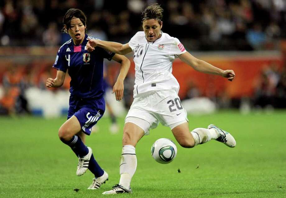 FILE - In this July 17, 2011, file photo, United States' Abby Wambach, right, controls the ball in front of Japan's Saki Kumagai, left, during the final match at the Women's Soccer World Cup in Frankfurt, Germany. Wambach, whose thunderous header in the final seconds of the Women's World Cup quarterfinals led the U.S. to an improbable victory and sparked a nationwide frenzy rarely seen for women's sports, has been voted the 2011 Female Athlete of the Year.  (AP Photo/Martin Meissner, File) Photo: Martin Meissner
