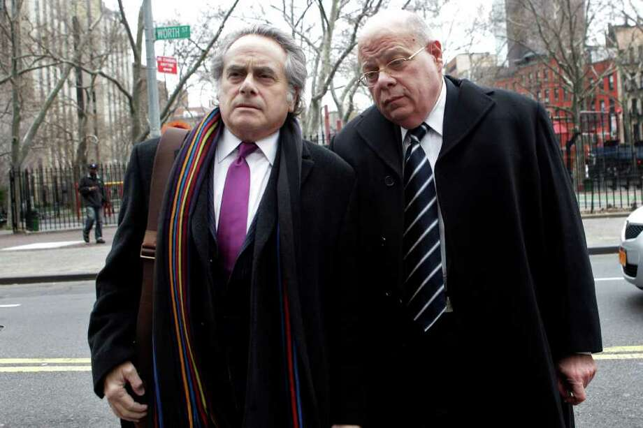 Sen. Carl Kruger, right, D-Brooklyn, arrives at federal court with his attorney Benjamin Brafman Tuesday, Dec. 20, 2011 in New York. Kruger was expected to plead guilty Tuesday in a wide-ranging influence-peddling case, according to a state officials. (AP Photo/Mary Altaffer) Photo: Mary Altaffer