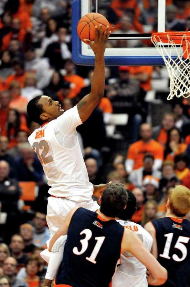 Syracuse's Kris Joseph scores against Bucknell during the first half of an NCAA college basketball game in Syracuse, N.Y., Tuesday, Dec. 20, 2011. Syracuse won 80-61. (AP Photo/Kevin Rivoli) Photo: Kevin Rivoli