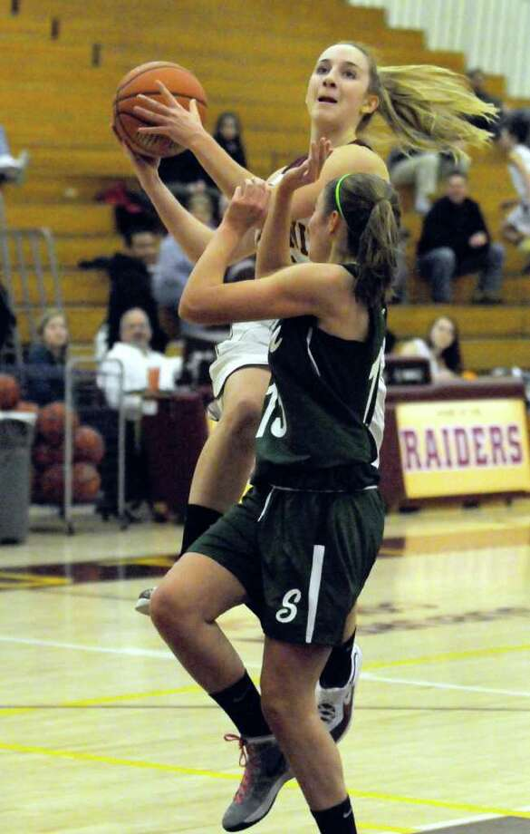 Ashley Loggins goes in for a score over Shen's Ali Lewis during their high school girls basket ball game in Colonie, NY Tuesday, Dec.20, 2011.( Michael P. Farrell/Times Union) Photo: Michael P. Farrell