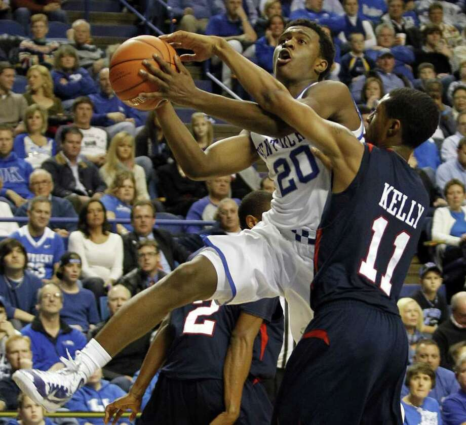 Kentucky's Doron Lamb, left, is fouled by Samford's Raijon Kelly during the second half of an NCAA college basketball game in Lexington, Ky., Tuesday, Dec. 20, 2011. Lamb scored 26 points and Darius Miller added 17 to lead No. 3 Kentucky in an 82-50 rout over Samford  to extend the Wildcats' home winning streak to 41 games. (AP Photo/James Crisp) Photo: James Crisp