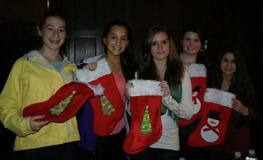 Pictured at the holiday meeting are members of the Class of 2015 Lauren Williams, Nicole Curto, Mary Corcoran, Fiona VonOehsen and Danielle Balzano display the decorated stockings. Photo: Contributed Photo