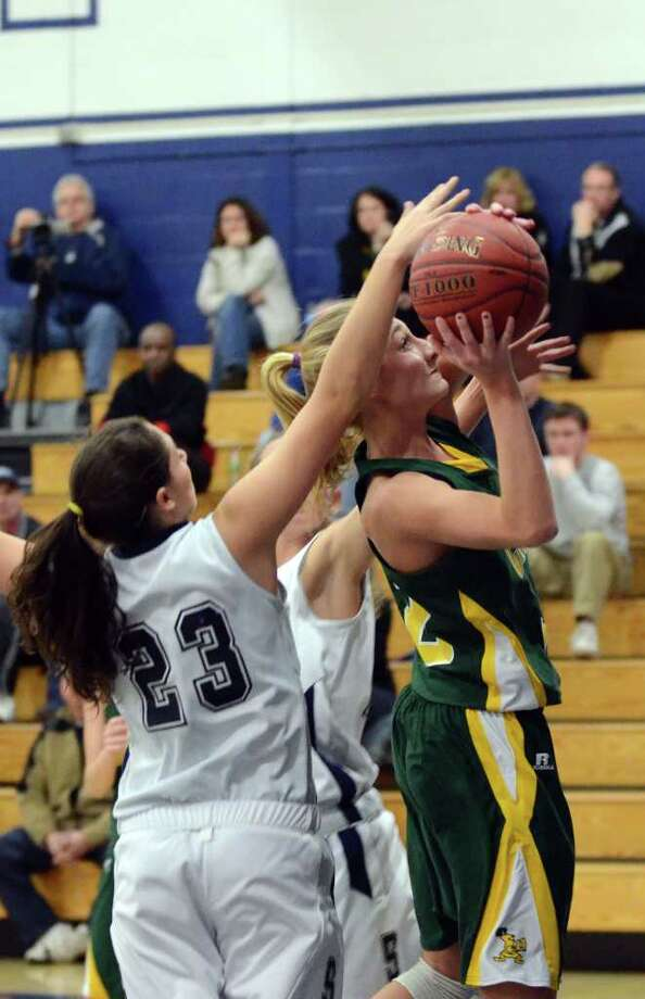 Staples' Sophie deBruijn (23) defends against a shot attempt by Trinity Catholic's MacKenzie Griffin (42) during the girls basketball game at Staples High School on Tuesday, Dec. 20, 2011. Photo: Amy Mortensen / Connecticut Post Freelance