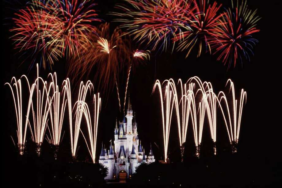 ** FOR IMMEDIATE RELEASE **In this undated photo courtesy of Disney, Fireworks surround Cinderella Castle at the Magic Kingdom in Walt Disney World in Lake Buena Vista, Fla. Photo: DISNEY, AP / DISNEY