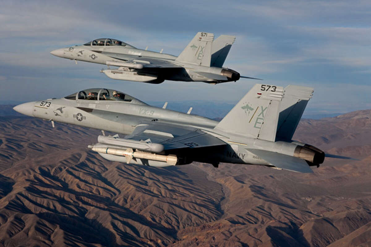 Two Boeing EA-18G Growler airborne electronic attack aircraft conduct a test flight. (Boeing) The Navy tests carrier landings on Whidbey Island, which has generated strong protests in Coupeville.L