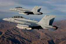 Two Boeing EA-18G Growler airborne electronic attack aircraft conduct a test flight. (Boeing)