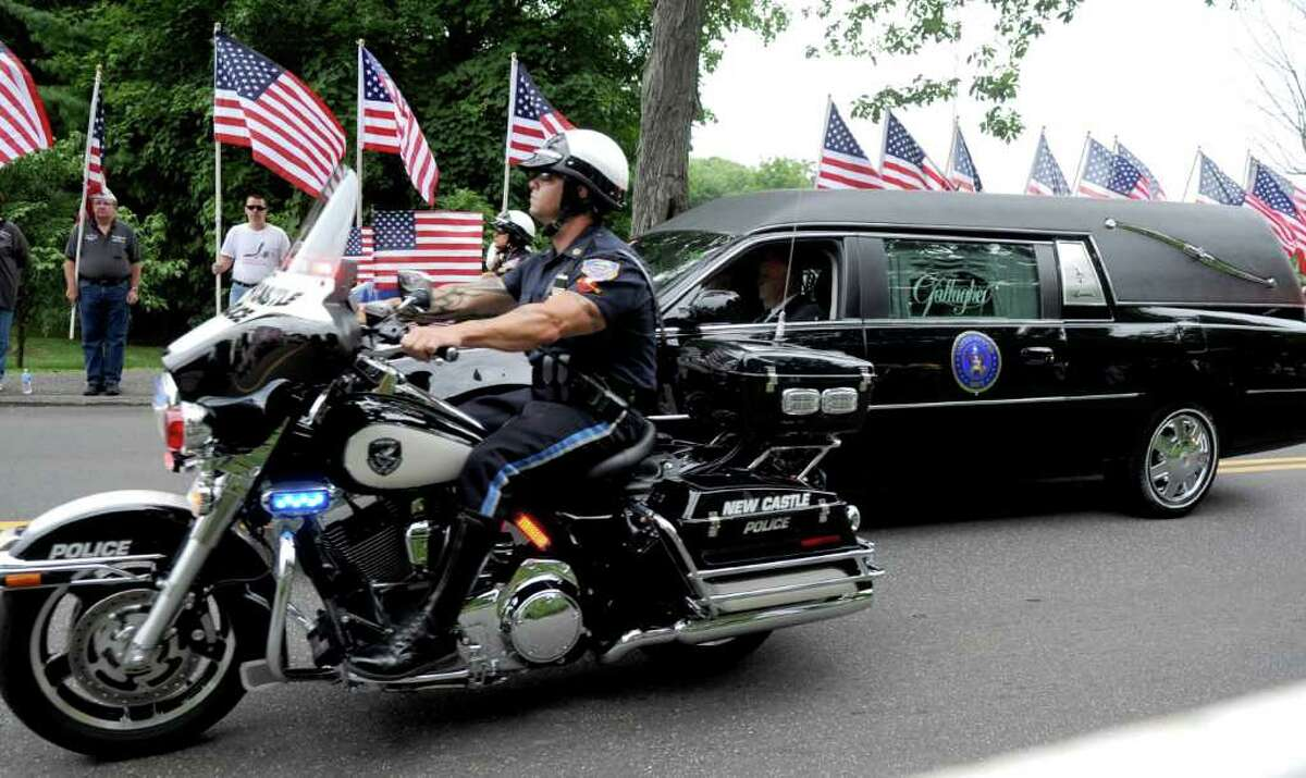 The funeral procession for U.S. Navy SEAL Brian Bill drives into St. Cecilia Parish in Stamford, Conn. on Friday, August 19, 2011. Malloy, a friend of Bill's family, attended the funeral Mass. The governor's official responsibilities include comforting the families of the war dead.