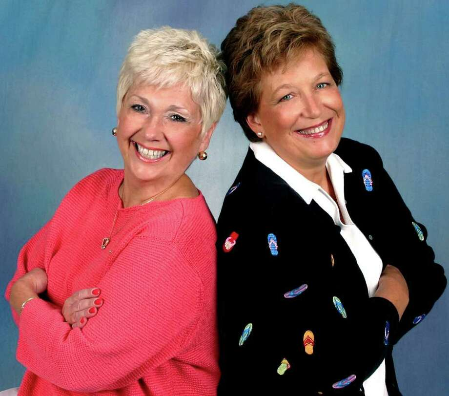 """SPECTRUM/Lynn Strawson, left, and Eileen """"Tinker"""" Hickey, co-owners of Cruise Holidays in New Milford, have been honored for operating one of the top franchises among the hundreds in the Cruise Holidays chain. December 2011  Courtesy of Cruise Holidays Photo: Contributed Photo"""