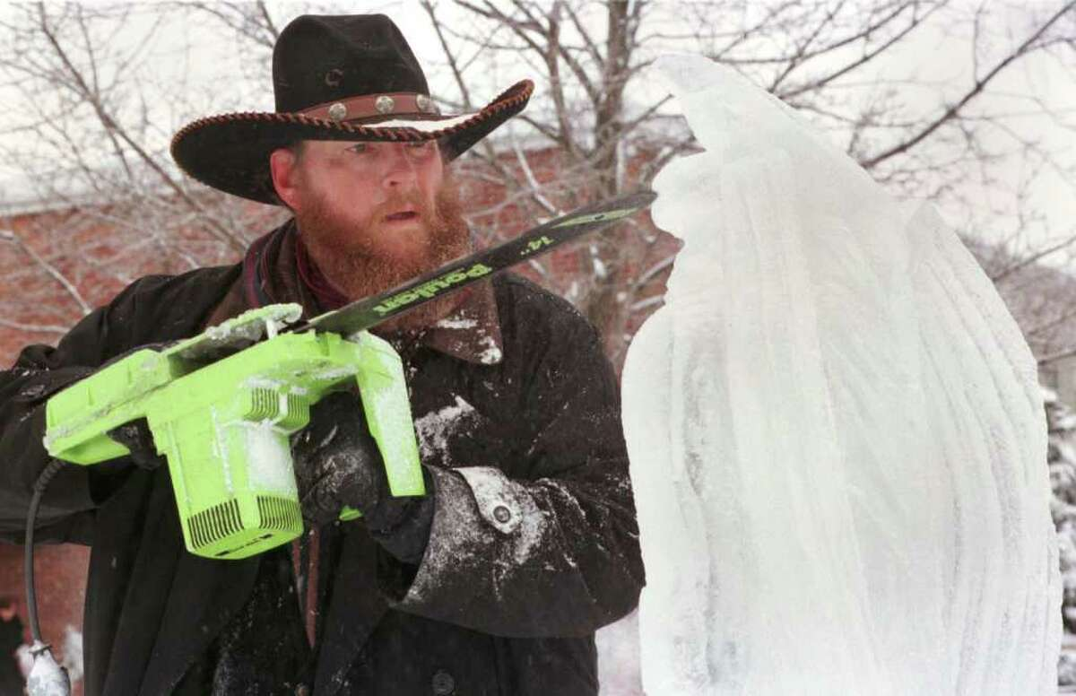 Times Union Staff Photo by Jonathan Fickies -- Ice carver Frank Carpinello works on a gargoyle for an ice caslte that was built at Goff Middle School during Winterfest '99 at Saturday, January 16, 1999. HOLD FOR TUESDAY DAN HOWLEY COLUMN