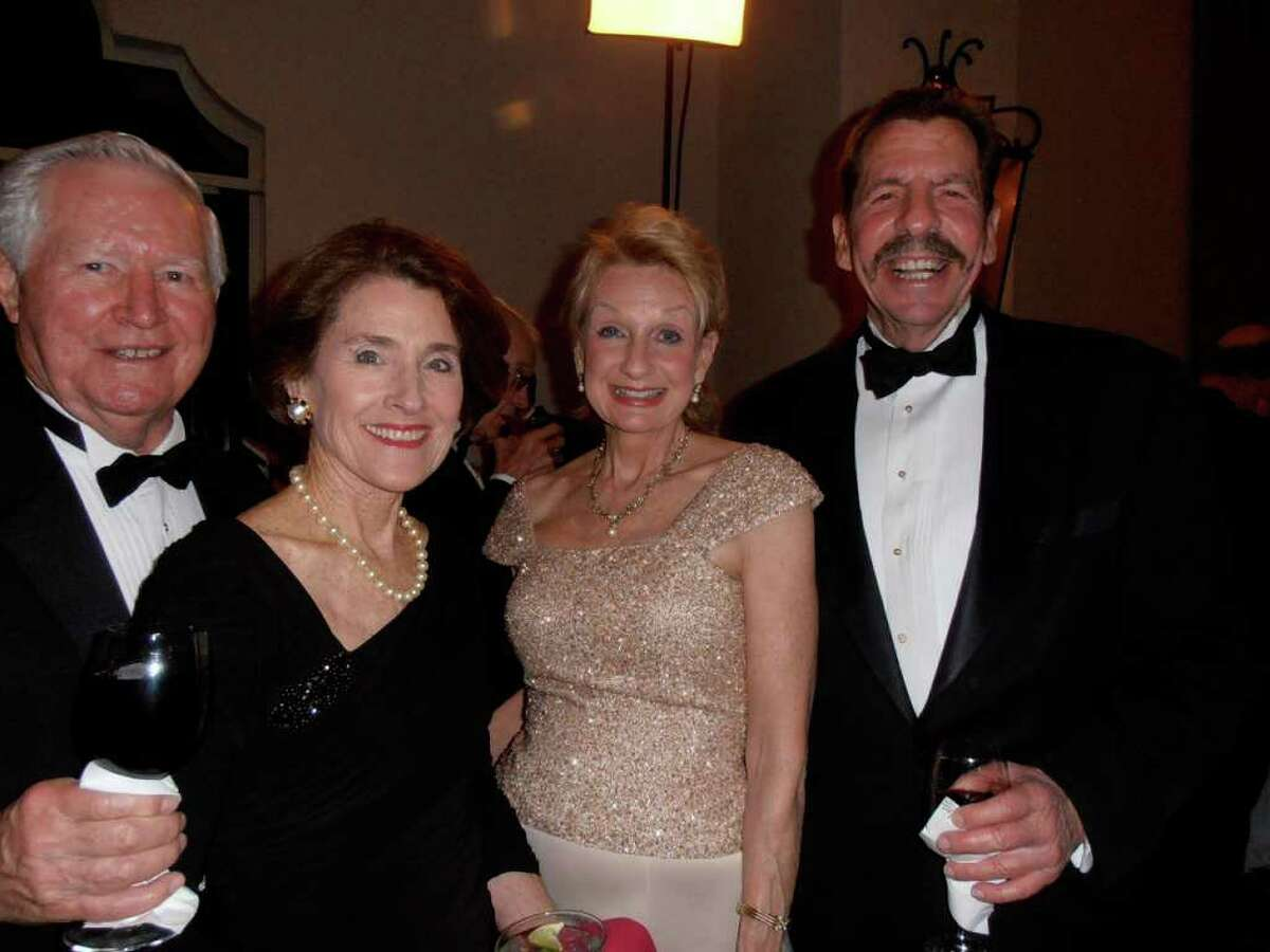Ron Keller, from left, visits with Sharon Kocurek and Leslie and Richard Bennett at the Poinsettia Ball at the Westin La Cantera.