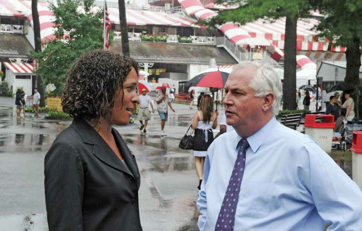 Ellen McClain, executive vice president and chief operating officer of NYRA, speaks with Charles Hayward, president and CEO of NYRA, at the Saratoga Race Course in Saratoga Springs, N.Y. Aug. 8, 2011. (Skip Dickstein / Times Union archive)