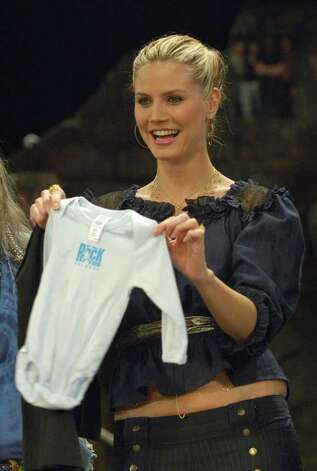 What you want -- Onesies and a lot of them. A five-pack of Gerber onesies is the most requested item in Amazon's clothing section. Model Heidi Klum shows off an unidentified piece of baby haute couture. Photo by Henning Kaiser/AFP/Getty Images. Photo: HENNING KAISER, N / 2005 AFP