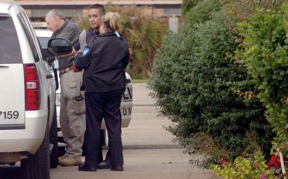 Beaumont police investigate the scene where a 73-year-old woman was found dead in her condominium on Prutzman Road in Beaumont Friday afternoon. Pete Churton/The Enterprise Photo: Pete Churton