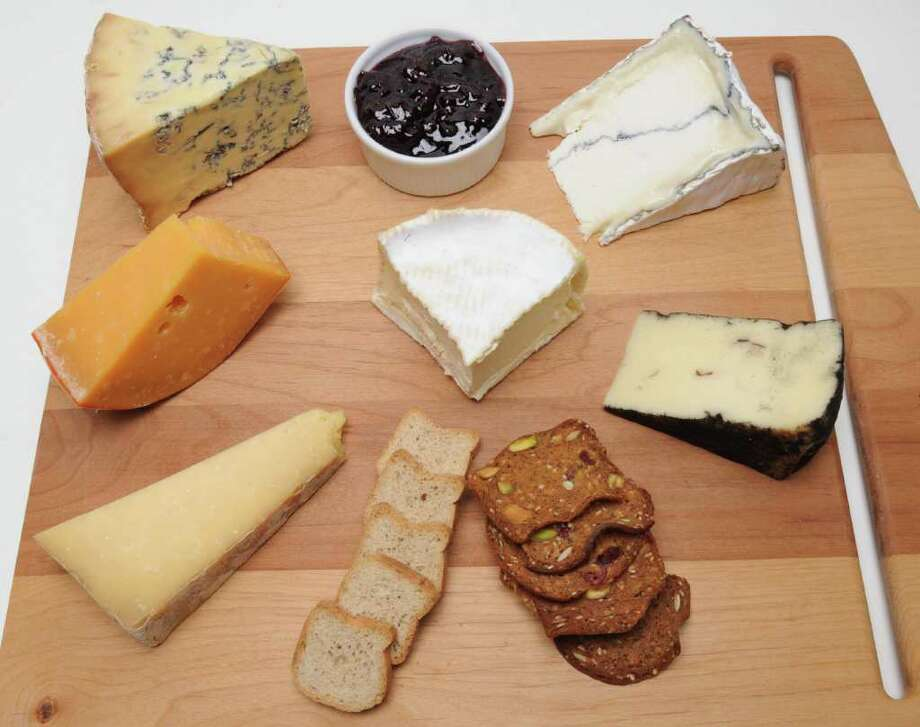 Cheese tray: Clockwise from bottom left, Cabot Clothbound, Beemster XO, Colston Bassett Stilton, Humboldt Fog, Truffle Falls, and Brillat Savarin is in the middle. (Lori Van Buren / Times Union) Photo: Lori Van Buren