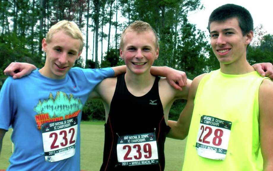 SPECTRUM/The New Milford High School trio of, from left to right, John Hansell, Noah Rossiter and Ryan Clarke, competed Dec. 10 in the national Junior Olympics age-group, cross country championships in Myrtle Beach, S.C.  Courtesy of Irene Clarke Photo: Contributed Photo