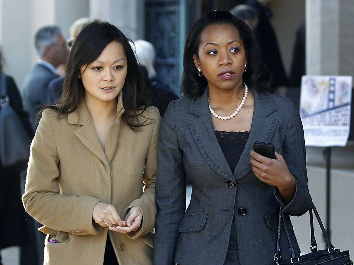 Supervisors Carmen Chu and Malia Cohen arrive for the memorial service for financier Warren Hellman at Temple Emanu-El in San Francisco, Calif. on Wednesday, Dec. 21, 2011. Hellman died Sunday night at the age of 77.